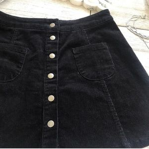 Rare black corduroy button down skirt
